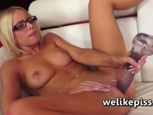 Kiara lord pulls a massive dildo from her pussy before eurpting in a piss...