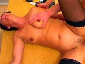 Mature brunette gets fucked by two horny duded in a hospital.