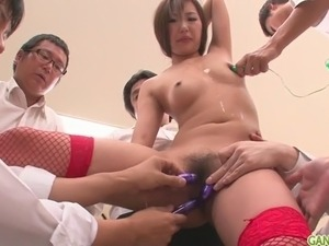 Natsuki is an asian girl giving blowjob to a group