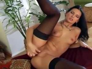 Beautiful brunette masturbates in black nylon free