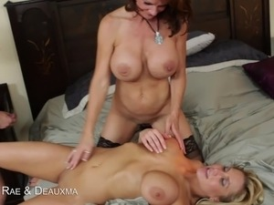 Two big titted blondes switch off sucking a big hard cock balls deep in their...