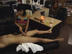 a girl giving a handjob