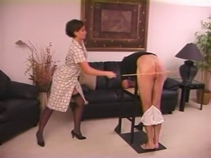 older woman spanking young girl