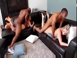 black guy kissing wife