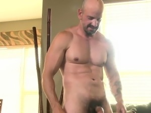 Solo hunk masturbating before cumming
