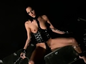 blonde wearing black latex stripping