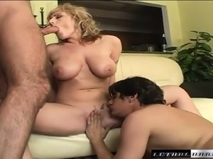 Bodacious blonde cougar in heat Velicity takes on two throbbing dicks