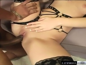 Buxom blonde nympho in stockings struggles with a massive black dick