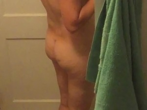 Spying wife getting ready to shower