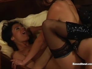 Lesbian slave pleasuring mistress with strapon