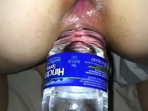 beer bottle in her pussy