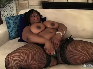 Dark skinned plumper in black stockings enjoys her time with sex toys