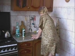 Big titted milf in kitchen