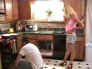 Lesbians having sex in the kitchen