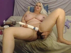 Masturbating and riding a huge dildo