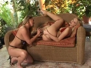young blond girl using vibrator