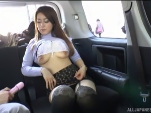 Long hair Asian model refined lovely with toy in the car