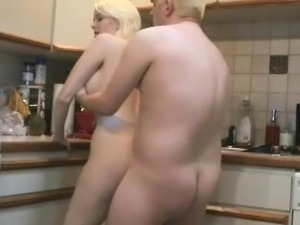 Big titted milf in the kitchen