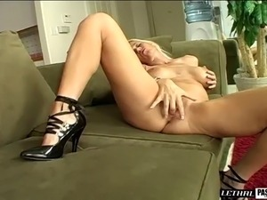 Horny Tabitha with fake tits moans while her pussy is licked