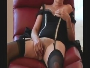 sexy mature lady having fun in a chair