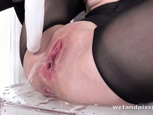 Hot slut in body stockings masturbates pussy and pisses in the bowl