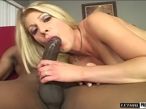 Charming shaved pussy babe giving big black cock blowjob