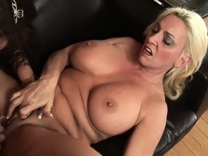 Lesbian MILFs have hardcore lick session on the couch