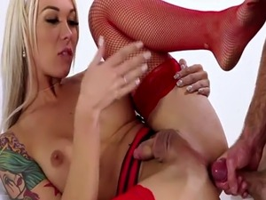Sexy blonde shemale Aubrey Kate teases in front of the camera and gets