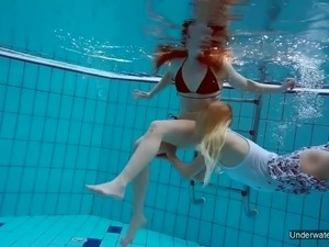 girls underwater in pool naked