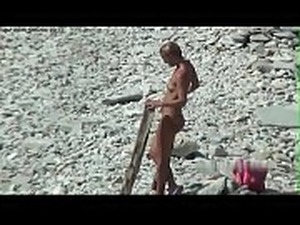 Teens naked on beach